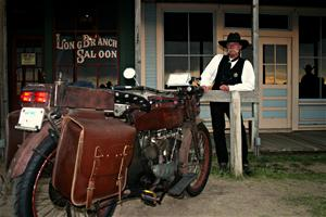 Man in costume in front of Long Branch Saloon