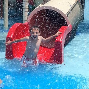 Young boy at waterslide